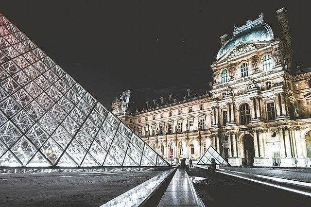 A large building in the background with Louvre in the background